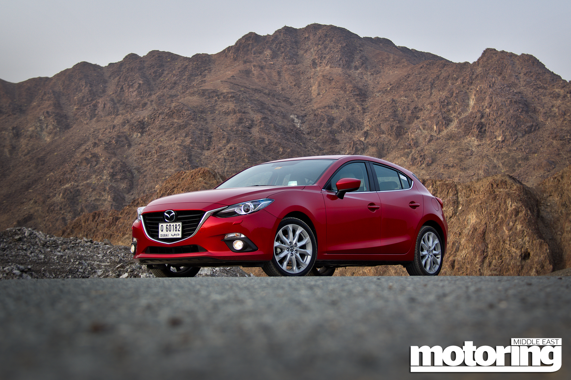 car cars review price action hatchback specs new mazda prices side