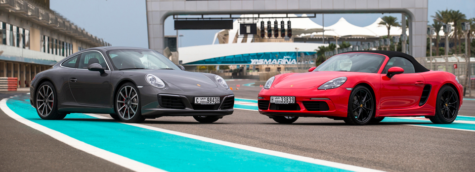We get our first taste of the latest all-turbo 911s & all-new four-cylinder 718 Boxster on road & track in Abu Dhabi